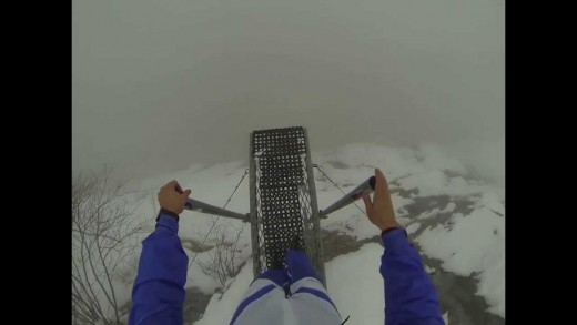 Man Base Jumps From Foggy Mountain