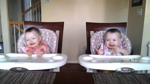 11-Month-Old Twins Enjoy Listening To Daddy's Guitar
