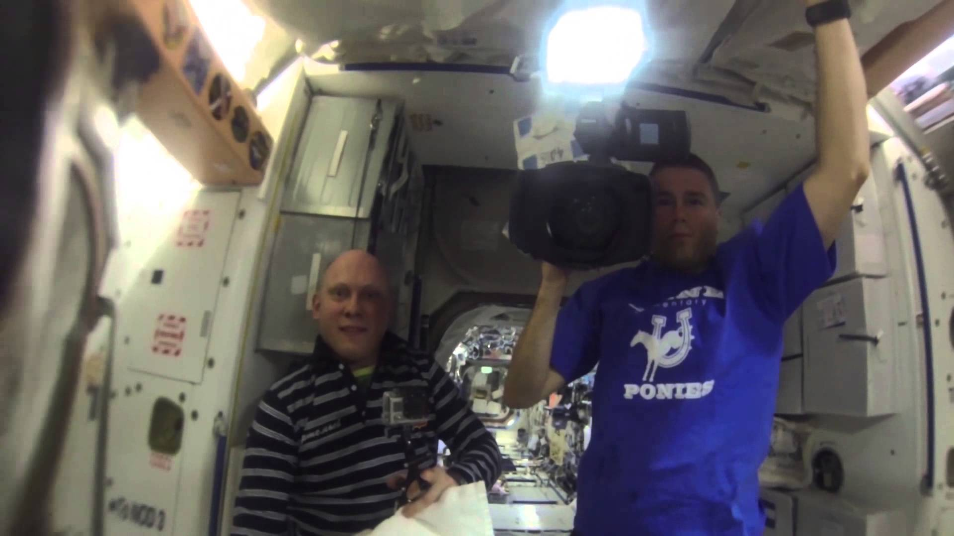 Astronauts Play with Water Bubble in Space